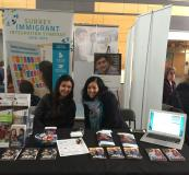 Kue and Jenn at the Surrey LIP booth at the Career Fair
